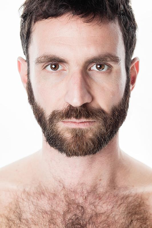 Portrait of Italian actor Davide Barbato on white background