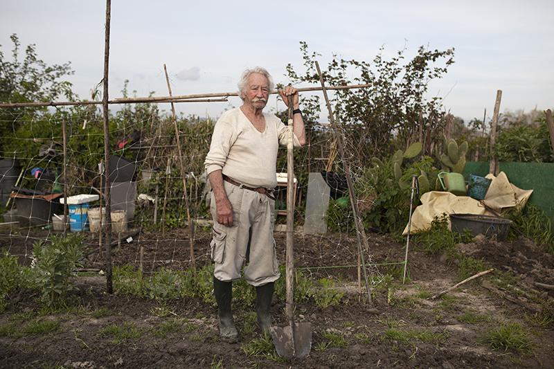 Portrait on an elderly man in his garden