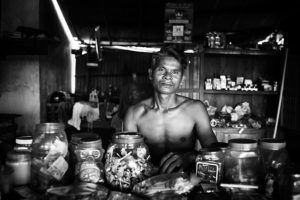 Portrait of a shop owner in his shop in Kampot, Cambodia