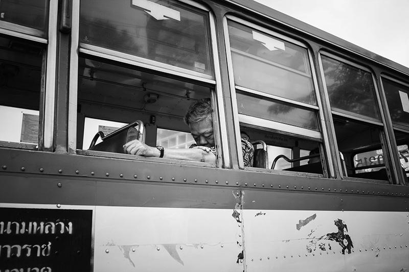 Man sleeping on a Bus in bangkok