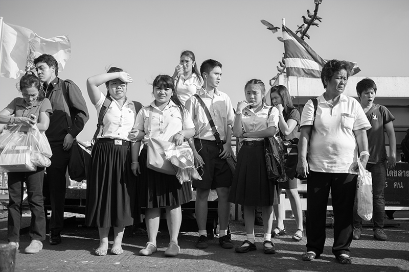 Students waiting for the ferry in Bangkok - Tahiland