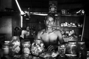 portrait of  a shop keeper in Kampot, Cambodia