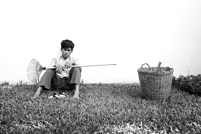portrait of a gardener outside a luxury hotel in Siem Reap, cambodia